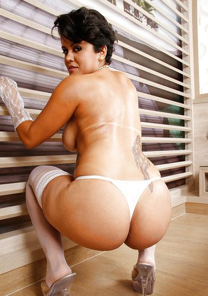 Busty Latina MILF Carol Paixao modeling non nude in lingerie and stockings