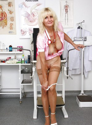 Mature blonde nurse Mia Hot posing for dirty pictures in uniform and hose