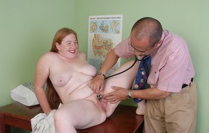 Mature redheaded fatty Keno giving thick cock a bj in exam room