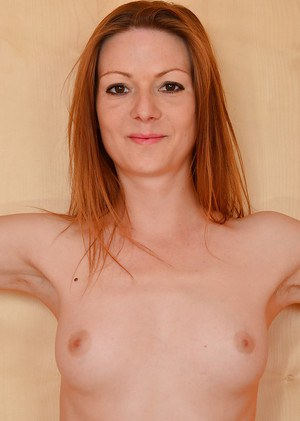 Skinny mature redhead Mischelle removing top to bare small tits