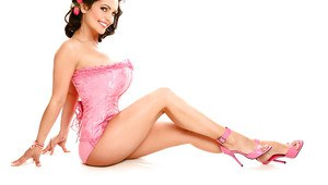 Chesty Italian pinup model Denise Milani modeling non nude in corset