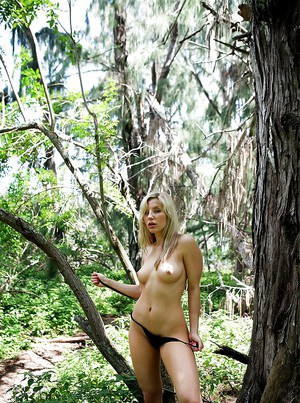 Hot blonde first timer Ashley Fires undressing for masturbation in woods