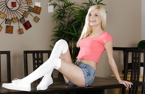 Young blonde pornstar Piper Perri posing fully clothed in denim shorts