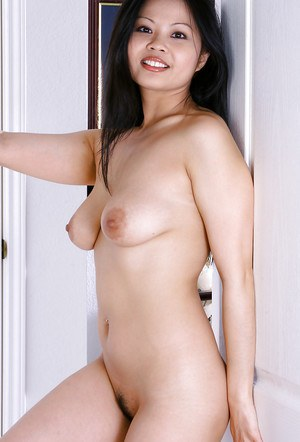 Oriental first timer Ayane pulls shirt over head to reveal natural breasts