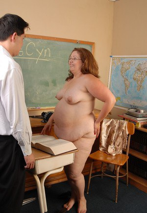 Obese schoolteacher Vyn undressing in classroom to deliver blowjob