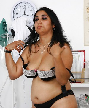 Overweight Indian woman Alice stripping down to stockings in gyno office