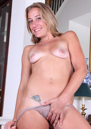 Leggy blonde lady Sky flashing her older MILF tits and shaved cunt