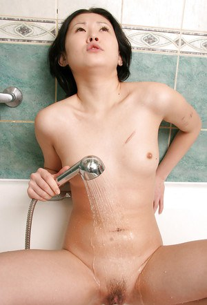 Petite Oriental first timer Dia masturbating hairy pussy with shower head