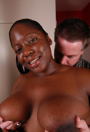 Overweight black woman Dynasty giving short white cock a blowjob