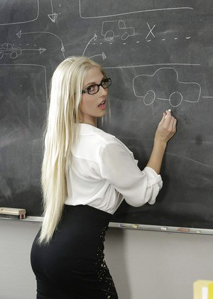 Blonde schoolteacher Christie Stevens posing nude in glasses