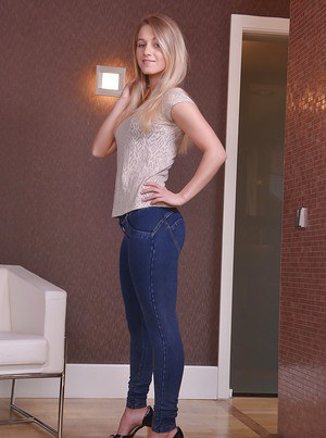 Tall blond solo model Tery posing non nude in denim jeans before undressing