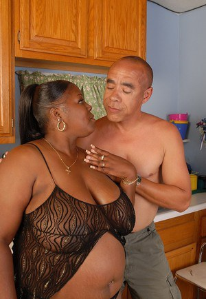 Black BBW Subrina having her huge boob sprayed with cumshot