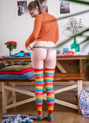 Blonde amateur Katherine J getting dressed after posing in the nude