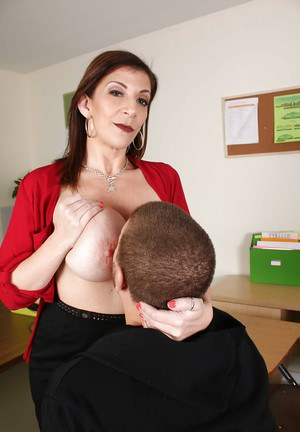 Chesty teacher Sara Jay fondles big tits while giving student blowjob