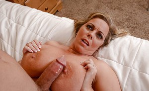 Chesty cougar Amber Lynn Bach and her big hanging tits give blowjob