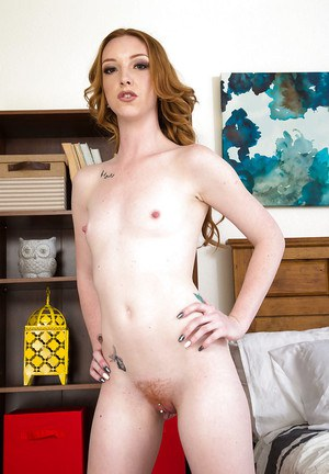 Redheaded solo babe Katy Kiss undressing to expose pierced pussy