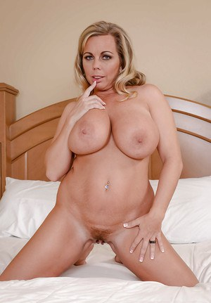Top heavy blonde lady Amber Lynn Bach showing off massive melons