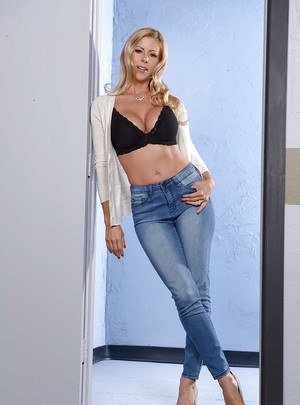 Blonde babe Alexis Fawx striking hot poses in blue denim jeans
