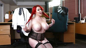 Chesty redhead Harmony Reigns showing off big boobs and butt in garters