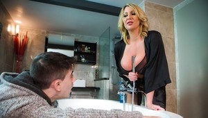 Chesty cougar Leigh Darby giving young boy his first blowjob