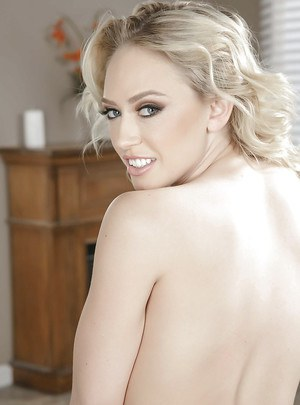 Blonde babe Kagney Linn Karter plays with her perfect set of big tits