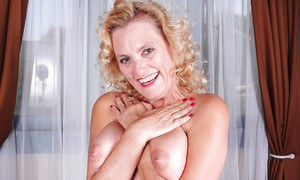 Blonde granny Lady Dalbin playing with nice pair of mature woman tits