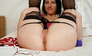 Short haired Euro mom Amber Clare showing off thong adorned ass
