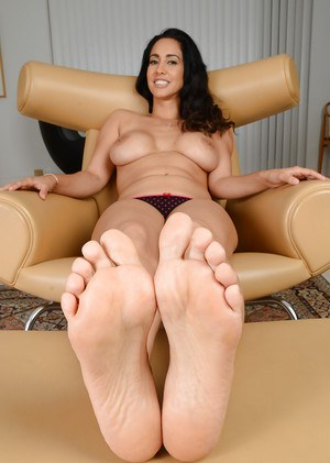 Tall Latina model Isis Love licking her own toes after undressing