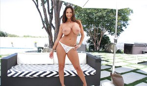 Top heavy solo babe Ava Addams modeling topless in denim shorts