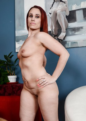 Redheaded MILF Crystal Rayne pulling white underwear up cunt crack