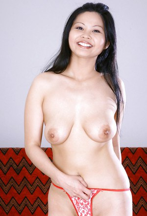 Young Asian hottie Ayane stripping naked for nude modelling session