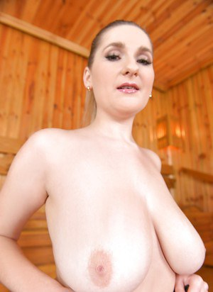 Solo model Auddi setting large all natural juggs free in sauna