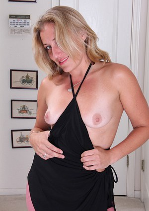 Over 30 blonde MILF Sky baring her small tits and shaved vagina