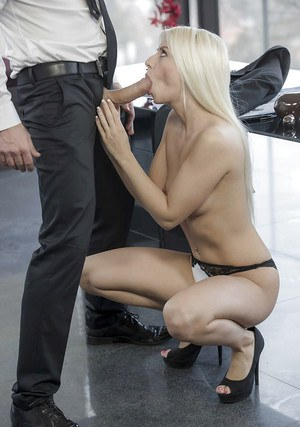Skinny blonde MILF Jessie Volt giving thick cock a blowjob in office