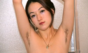 Young Asian amateur Hazel undressing for hairy underarm viewing