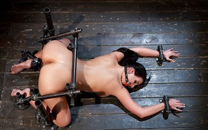 Brunette MILF Phoenix Marie taking anal fisting from female in bondage