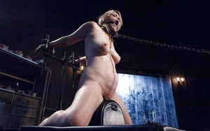 Curvy blonde Winnie Rider taking caning of shaved pussy up close