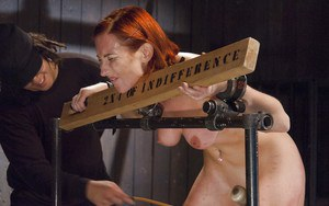 Redhead girl Sophia Locke taking electroshock and nipple torture in bondage