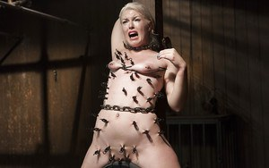 Defiant blonde teen Ella Nova having pink tongue clamped and shocked