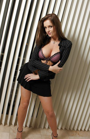 Naughty solo model Sandra Shine modeling non nude in short skirt