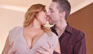 Curvy redhead Krystal Swift taking cumshot on large all natural boobs