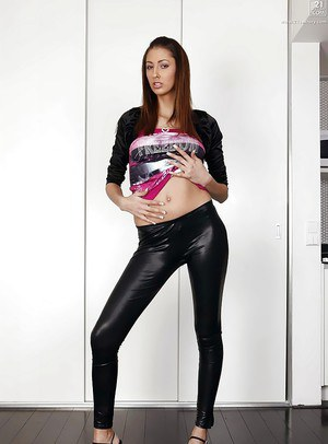 Beautiful European chick Kitty Jane strutting non nude in leather pants