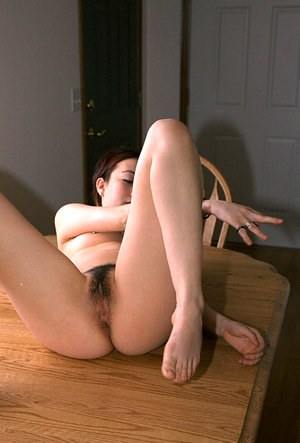 Asian amateur Hazel pulling panties to one side to expose beaver
