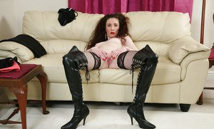 Skinny mature lady Scarlet striking hot non nude poses in stripper boots