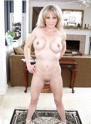 Over 50 blonde MILF Elizabeth Green flashing thong covered ass