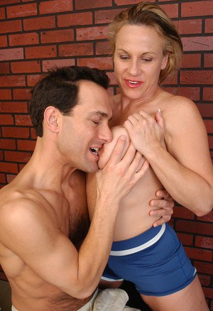 Older blonde lady Summer eating cumshot from hand after sports workout