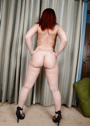 Solo MILF model Crystal Rayne revealing fat ass and shaved cunt