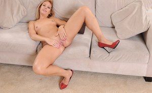 Older blonde babe Charli Shay spreading her pink pussy up close