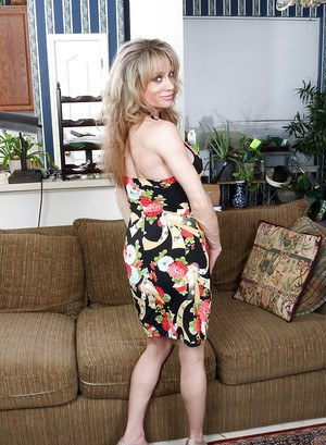 Hot mature blond Elizabeth Green strutting fully clothed in dress and heels