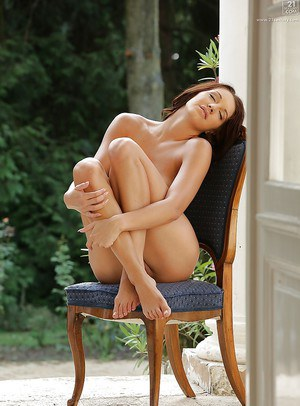 Beautiful pornstar Felicia Kiss and her sexy long legs modeling outdoors